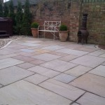 "Design & build using ""Lakeland"" natural paving and setts."