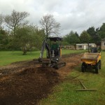 Preparation & leveling for grass seeding.