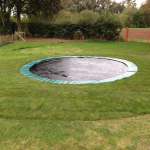 Trampoline dug into ground.